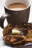 Buttered toasted teacake with a mug of tea