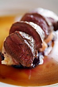 Roast venison loin fillet on red wine sauce