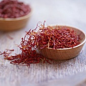 Saffron threads in wooden bowls