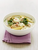 Rice noodle soup with chicken, baby corn and coriander