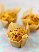 Savoury sweetcorn muffins in baking parchment