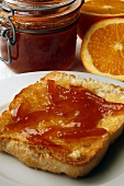 A slice of toast with orange marmalade