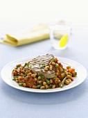 Grilled tuna steak on chick-pea salad