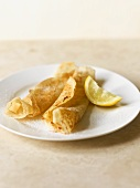 Rolled pancakes with sugar and lemon