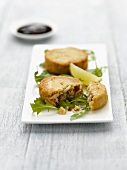 Filled fish cakes on rocket