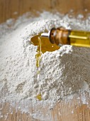 Adding olive oil to flour