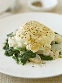 Poached egg on haddock with spinach