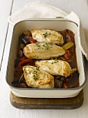 Roast chicken breasts on peppers