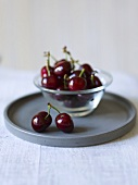 Cherries in a small glass bowl