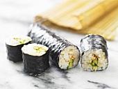 Cucumber maki sushi with sesame seeds