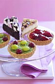 Assorted fruit tartlets and pieces of cake