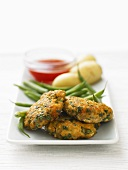 Fish cakes with green beans and potatoes