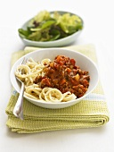 Spaghetti bolognese with side salad