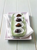 Chocolate truffles in paper cases