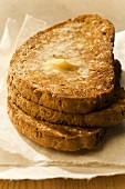 Toasted wholemeal bread with butter and honey