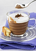 Chocolate mousse with cream topping and cantuccine