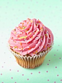 A cupcake with rosette of pink icing