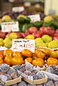 Various exotic fruits on a market stall