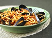 A portion of linguine with mussels and tomatoes