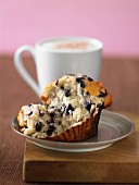 A blueberry muffin with a mug of coffee