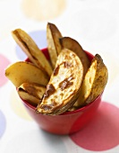Baked potato wedges in a bowl