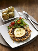 Goat's cheese & onion tart with rocket salad and potatoes