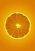Slice of orange against orange background