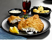 Battered plaice with potatoes and tartare sauce