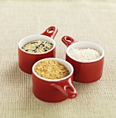Brown rice, basmati rice and wild rice in small pots