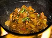Beef gosht in karahi (Indian cast-iron wok) over fire