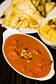 Chicken tikka masala with accompaniments