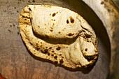 Naan bread in a tandoor