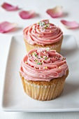 Cupcakes with pink icing and hundreds and thousands