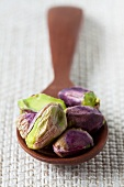 Pistachios on wooden spoon