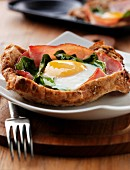 Ham, spinach and fried egg on toast