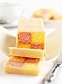 Battenberg cake, partly sliced