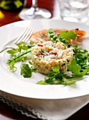 Prawn cake with young peas and rocket