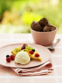 A piece of fruit flan with vanilla ice cream