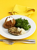 Pork medallion with baked potato and kale