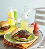 Hamburger, fruit juice and apple