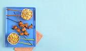 Salmon teriyaki kebabs with fried rice