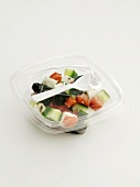 Greek salad in plastic container to take away