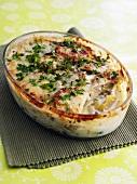 Potato gratin in glass baking dish