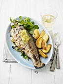 Roasted trout with lemon butter and roasted potatoes