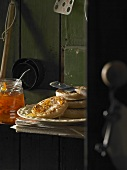 Buttered crumpets with orange marmalade in a pantry