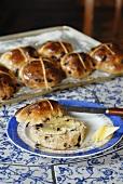 Hot cross buns, one buttered