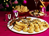 Different types of fingerfood on a plate, hors d´oevres (Christmas)