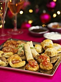 Christmas starter platter with appetizers, hors d`oevres