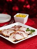 Roast ham on a white plate