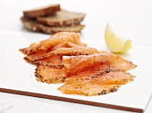 Scottish smoked salmon with lemon wedge
